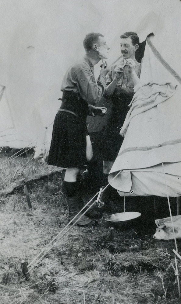 Private John Denholm (holding the mirror) at Sewell Camp in late June 1914