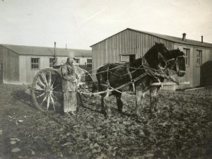 Water-cart and man in mud