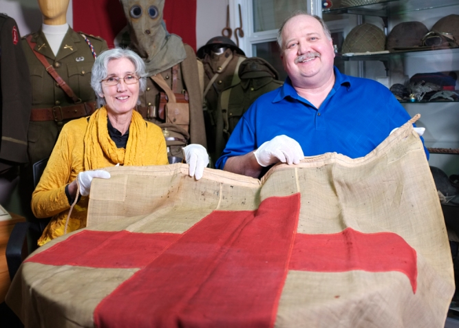 Wendy Lugg and Doug Buhler pose with the Gallipoli Red Cross Flag