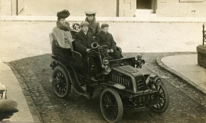 The Fleming family in Kilmarnock, 1907 (John driving, Wallace, mother Marion, May & Mary)