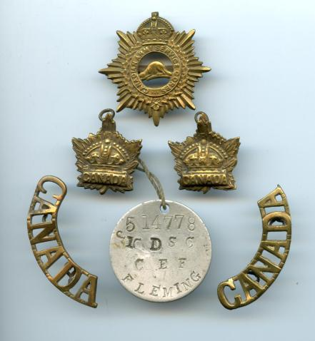 John Flemings CASC cap badge, collar badges, shoulder badges and ID tag