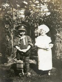 Pte. Valentine Hitchcock's niece (on left) wearing his uniform and Military Medal