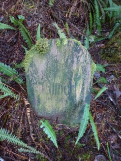 This cedar grave marker is one of the first encountered as you enter the cemetery